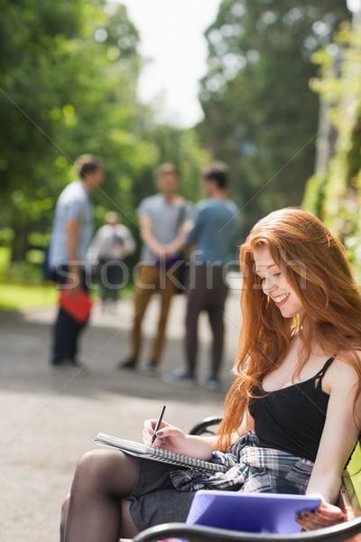 Pretty student studying outside on campus Stock photo © wavebreak_media