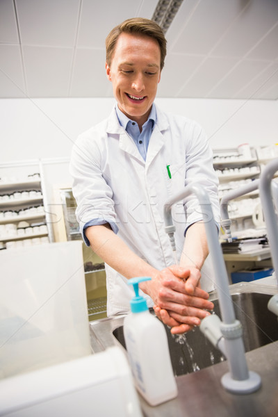 Pharmacist washing his hands at sink Stock photo © wavebreak_media