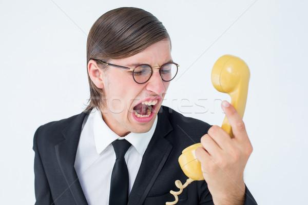 Geeky businessman shouting at retro phone  Stock photo © wavebreak_media