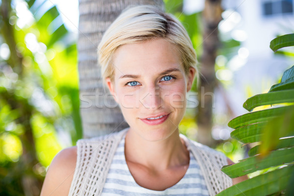 Pretty blonde woman smiling at the camera Stock photo © wavebreak_media
