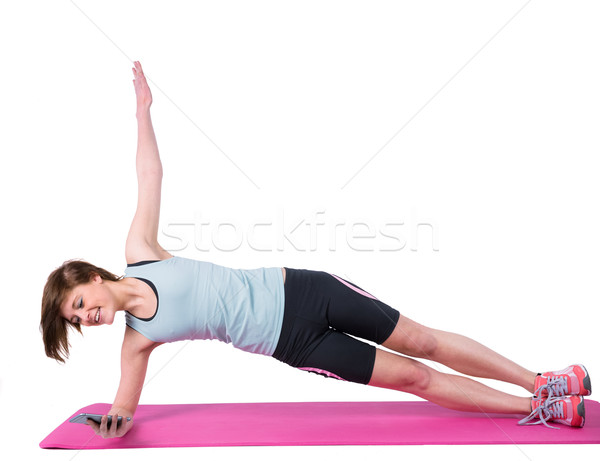 Pretty brunette doing side plank on exercise mat  Stock photo © wavebreak_media