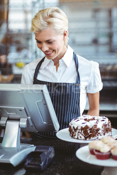 Mosolyog alkalmazott számológép pult pékség üzlet Stock fotó © wavebreak_media