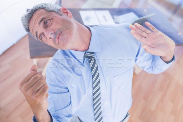 A serious businessman lifting something  Stock photo © wavebreak_media