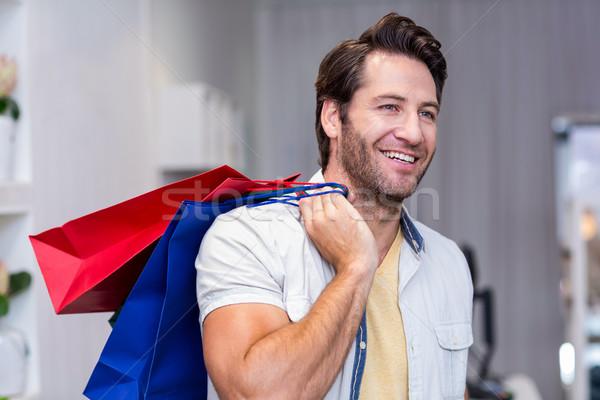 ストックフォト: 笑みを浮かべて · 男 · ショッピングバッグ · 服 · ストア · 青