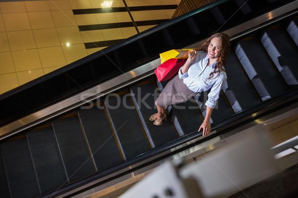 Güzel kadın yürüyen merdiven alışveriş portre kadın Stok fotoğraf © wavebreak_media