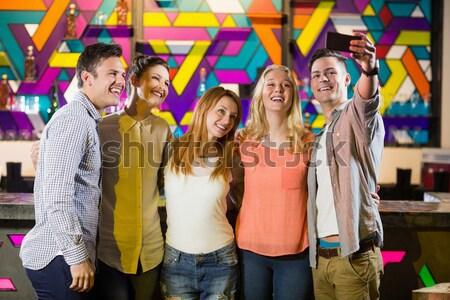 selfie in the party. Emoji heads. Stock photo © wavebreak_media