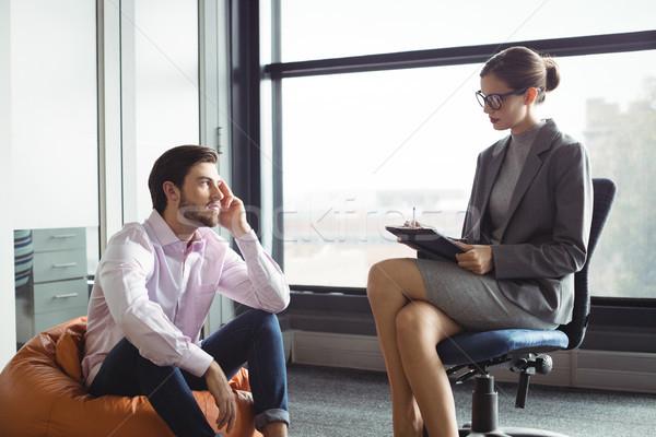 Infeliz homem falante conselheiro reunião caneta Foto stock © wavebreak_media