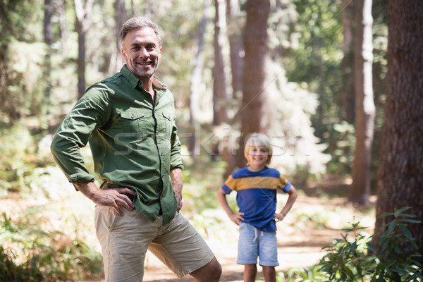 Father and son with hands on hips standing in forest Stock photo © wavebreak_media