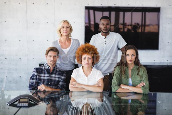 Portré kollégák asztal ül iroda üzlet Stock fotó © wavebreak_media