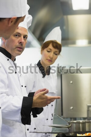 Team of chef preparing food in the commercial kitchen Stock photo © wavebreak_media
