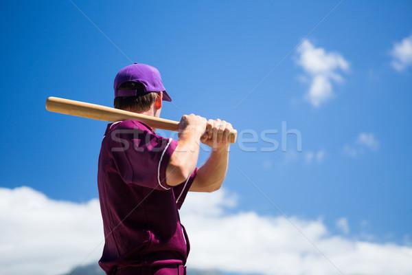 Zijaanzicht honkbalspeler bat blauwe hemel Stockfoto © wavebreak_media