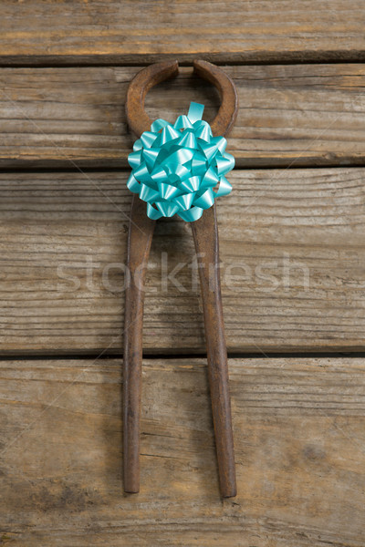 Overhead view of rusty tool decorated with ribbon Stock photo © wavebreak_media