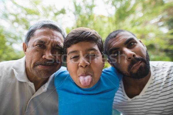 Portrait of happy multi-generation family making faces at park Stock photo © wavebreak_media