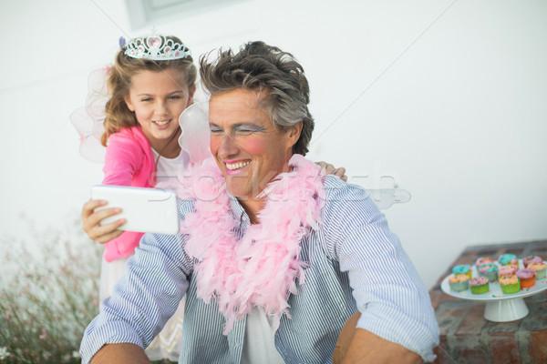 Cute figlia fata costume cellulare Foto d'archivio © wavebreak_media