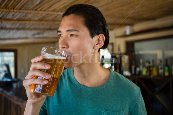 Thoughtful man drinking beer Stock photo © wavebreak_media