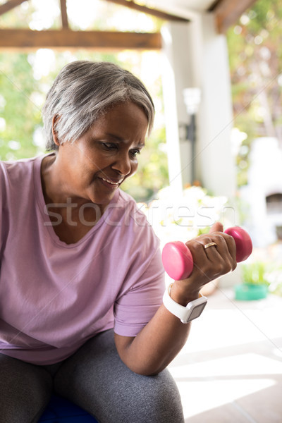 Close up of smiling senior woman exercising with dumbbell Stock photo © wavebreak_media