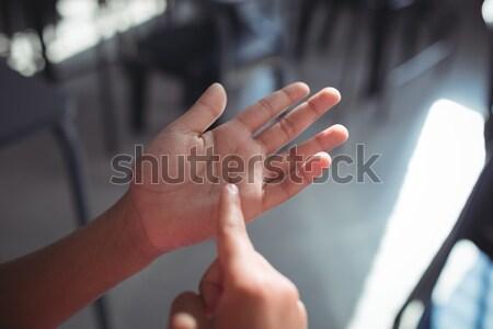 Cropped hands of girl gesturing Stock photo © wavebreak_media