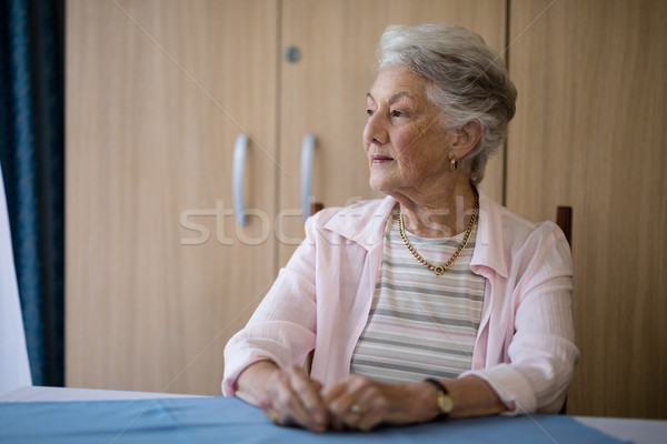 Thoughtful senior woman sitting at table Stock photo © wavebreak_media