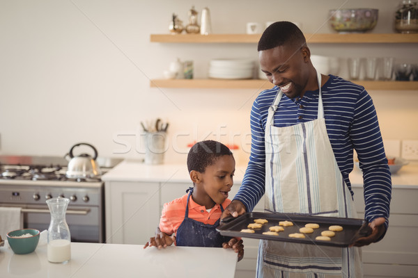 Father holding tray while son looking at cookies Stock photo © wavebreak_media