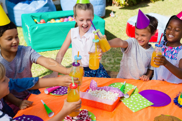 Magasról fotózva kilátás gyerekek pirít iszik üvegek Stock fotó © wavebreak_media