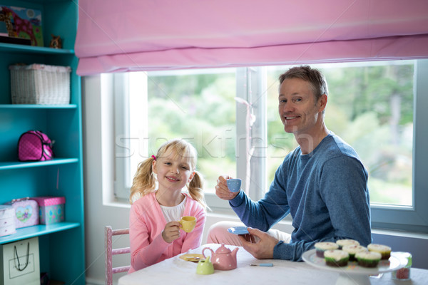 Father and daughter playing a tea set role play Stock photo © wavebreak_media