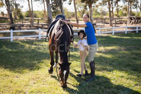 Portrait of siblings standing by horse Stock photo © wavebreak_media