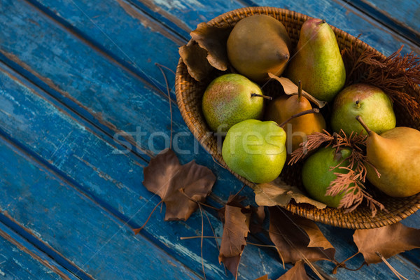High angle view of pears in wicker basket on wooden table Stock photo © wavebreak_media