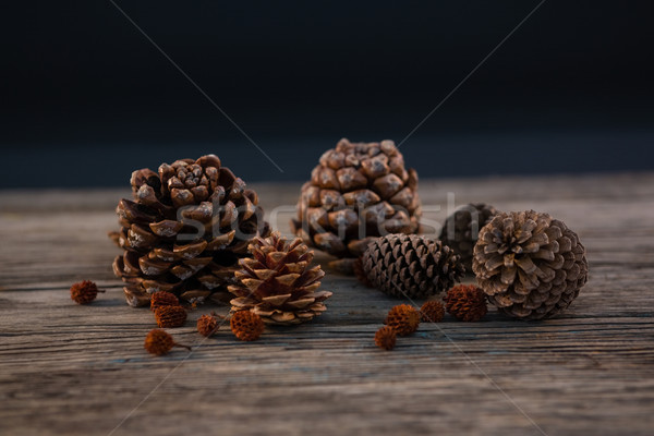 Close up of pine cones on wooden table Stock photo © wavebreak_media
