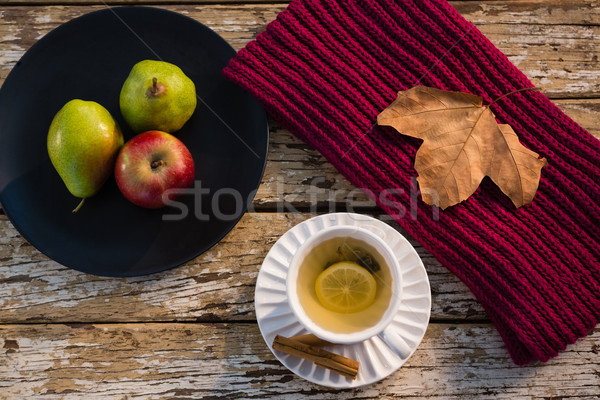 High angle view of lemon tea by fruits in plate on wooden table Stock photo © wavebreak_media