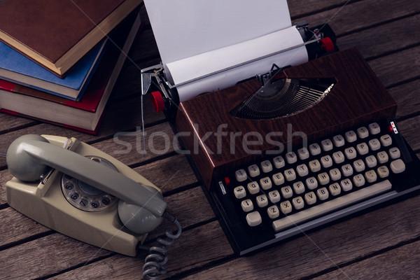 Overhead of vintage typewriter and telephone on wooden table Stock photo © wavebreak_media