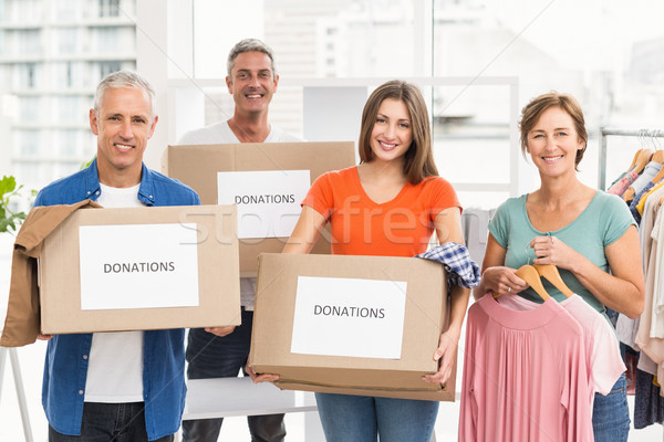 Souriant gens d'affaires contribution cases portrait Photo stock © wavebreak_media