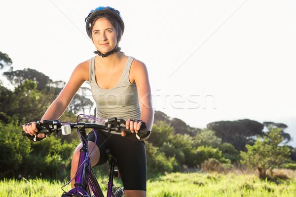 Fókuszált sportos barna hajú ül hegyi kerékpár természet Stock fotó © wavebreak_media