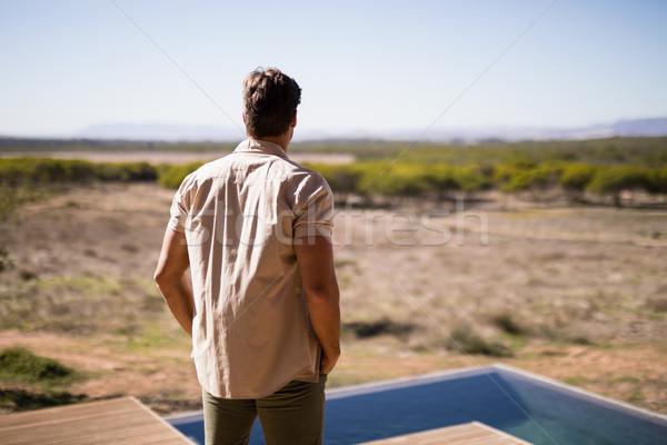 Rear view of man standing near poolside Stock photo © wavebreak_media