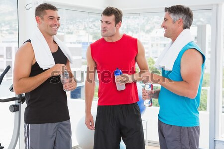 Fit smiling people discussing together Stock photo © wavebreak_media