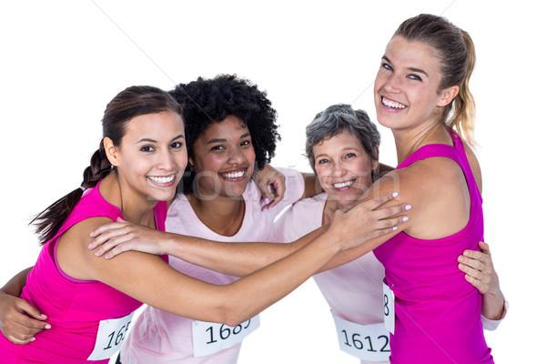 Portrait of happy athletes with arms around  Stock photo © wavebreak_media