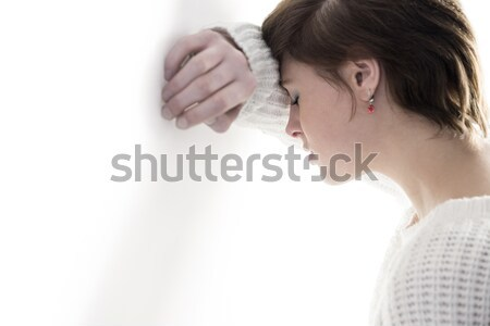 Stock photo: Peaceful woman praying with joining hands and eyes closed