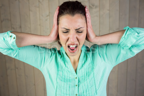 Woman with eyes closed while suffering from headache  Stock photo © wavebreak_media