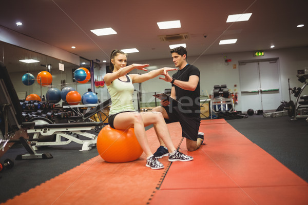 Fit woman working out with trainer Stock photo © wavebreak_media