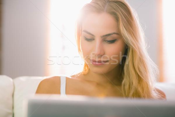 Pretty blonde using laptop on couch Stock photo © wavebreak_media