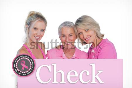 Find out more button with Get checked Text and Hand holding card with pink breast cancer awareness w Stock photo © wavebreak_media