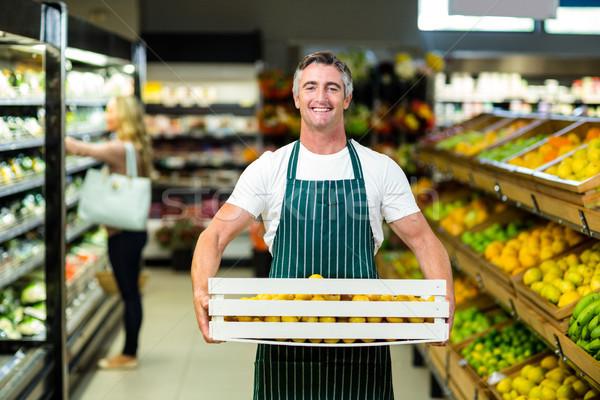 улыбаясь работник овощей окна супермаркета Сток-фото © wavebreak_media