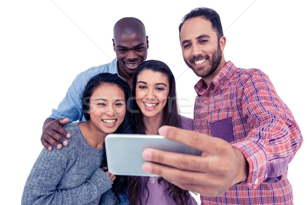 Smiling multi-ethnic friends taking selfie Stock photo © wavebreak_media