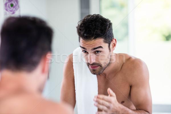 Przystojny półnagi człowiek patrząc lustra łazienka Zdjęcia stock © wavebreak_media