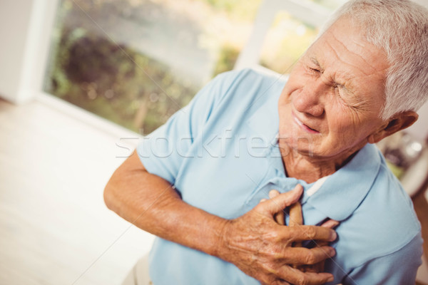 Painful senior man with pain on heart Stock photo © wavebreak_media