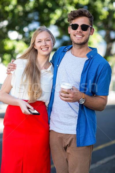 Hip friends smiling at the camera Stock photo © wavebreak_media