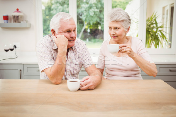 Senior couple talking to each other while having coffee Stock photo © wavebreak_media