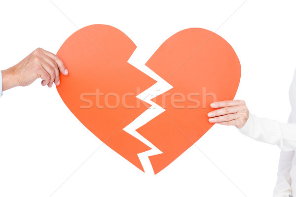 Stock photo:  Couple holding broken heart