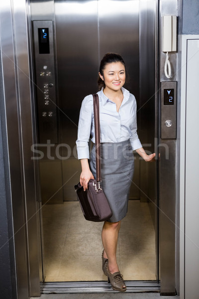Businesswoman standing in an elevator Stock photo © wavebreak_media