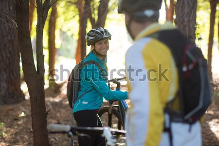 Young couple holding zip line cable while crossing obstacle in the forest  Stock photo © wavebreak_media