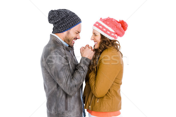 Young couple in warm cloth standing face to face and shivering Stock photo © wavebreak_media